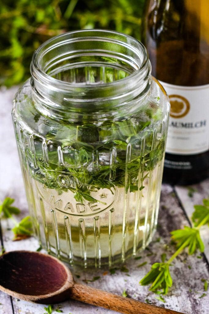 soaking the herb in wine in large jar