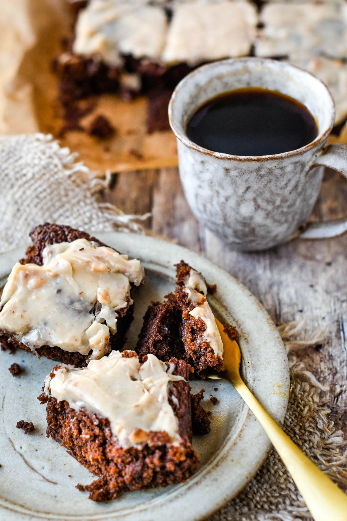 fork with brownies and cup of coffee