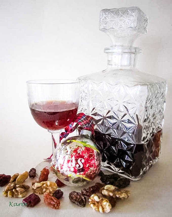 long shot showing decanter, glass, plus fruits and nuts