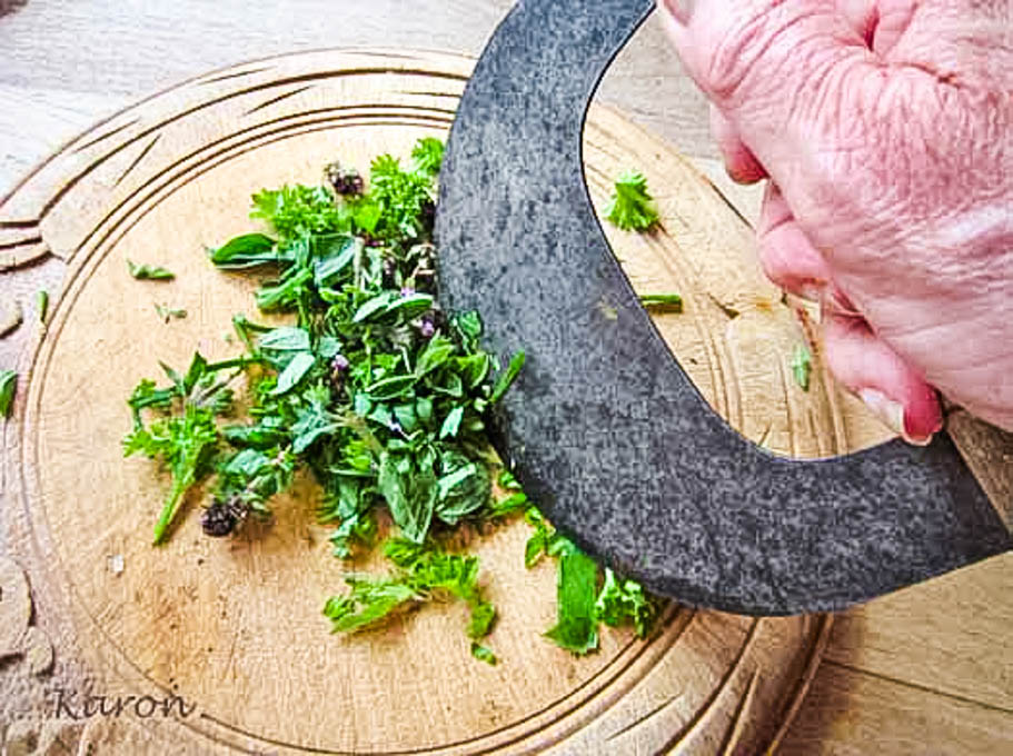 chopping herbs on wooden board