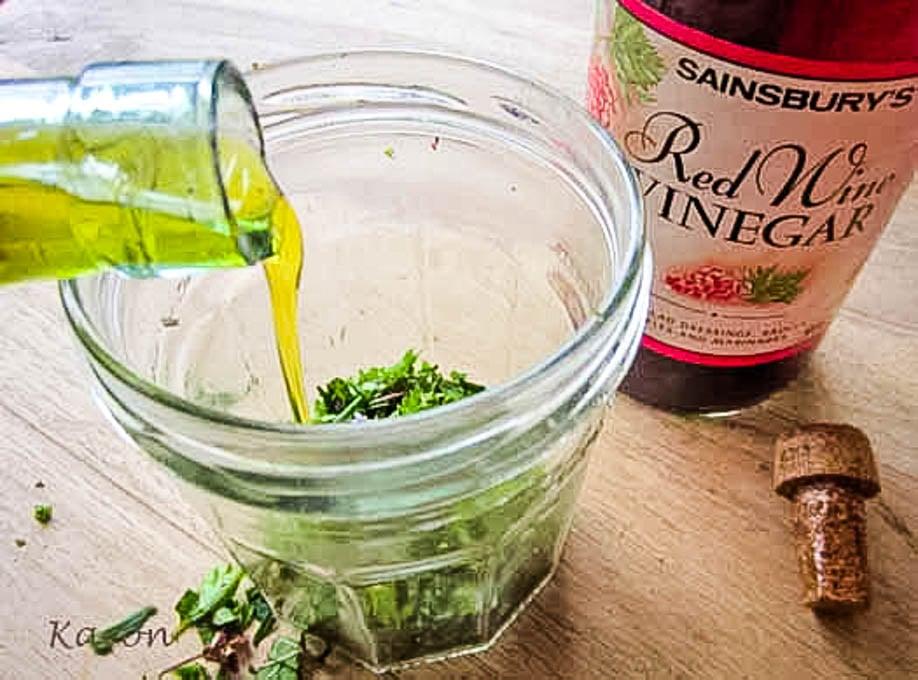 pourinhg oil into dressing jar