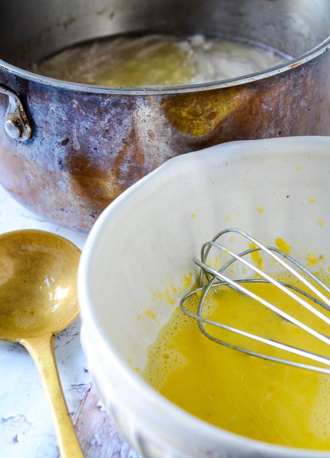 whisking eggs and lemon for avgolemono