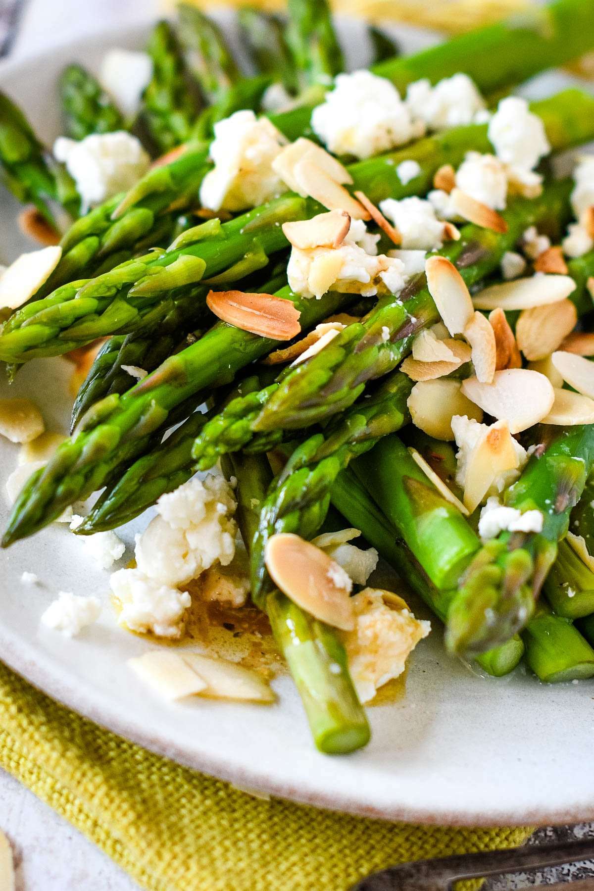 close up of finished dish of asparagus, feta and almonds