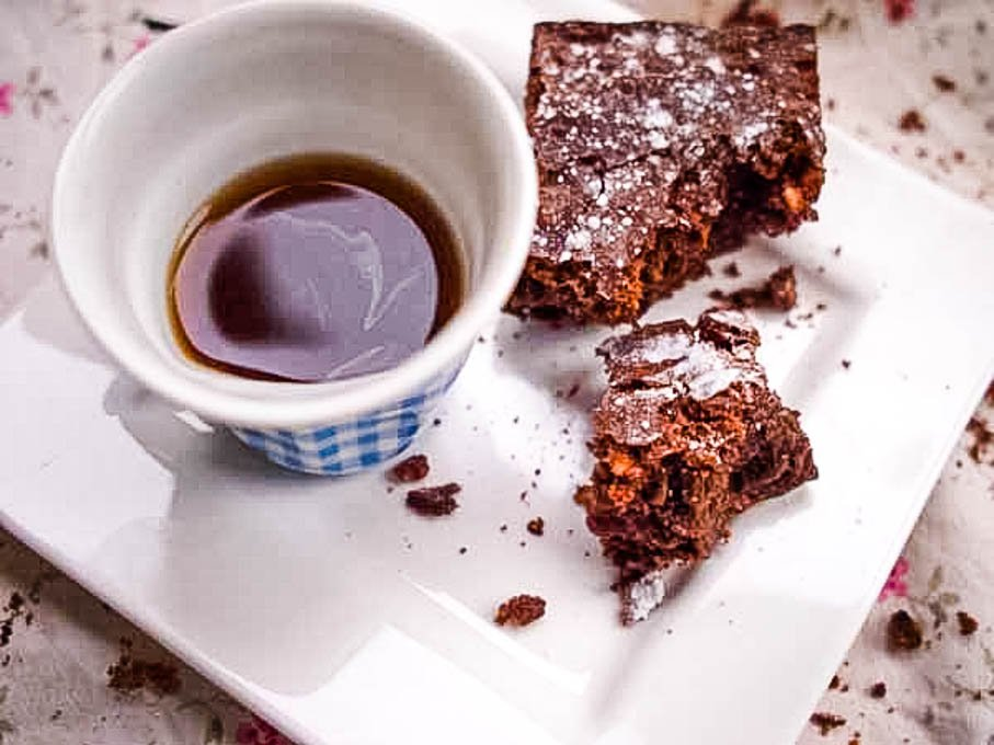 top down shot of coffee cup with brownie beside it
