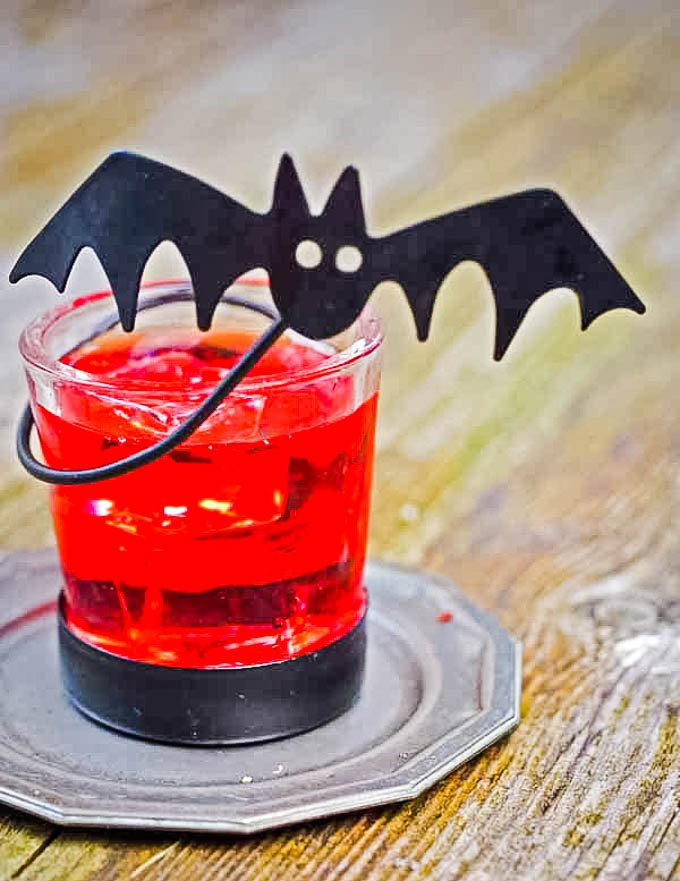 spooky martini halloween cocktail in bat glass