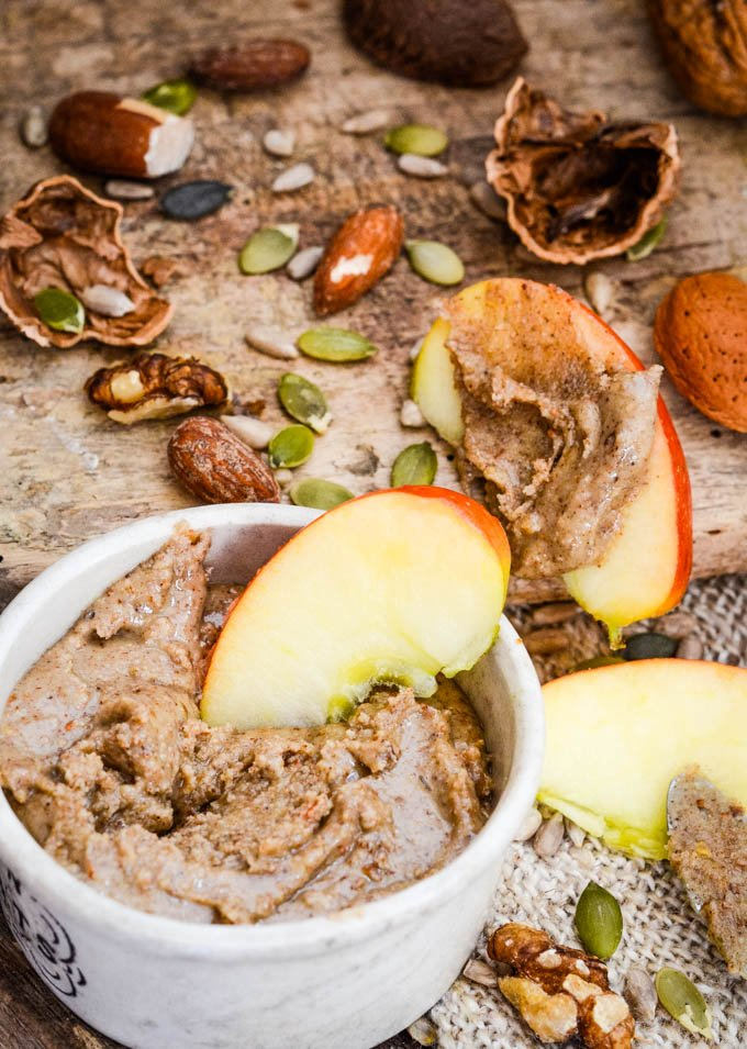 apple dipping into bowl of nut butter