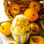 golden plum ice-cream with plums behind
