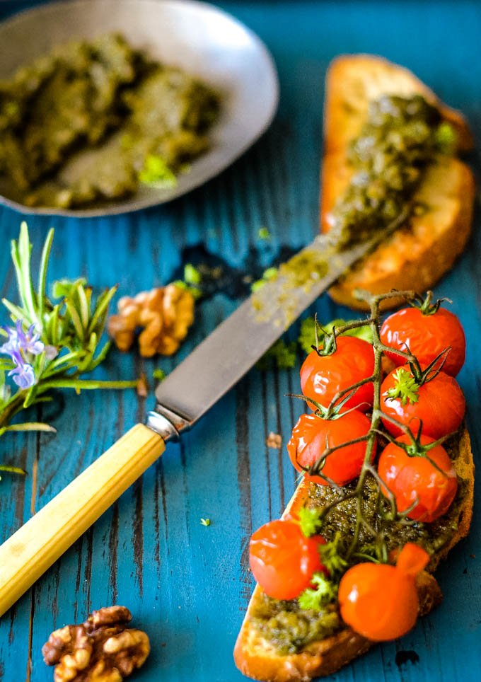 rosemary and walnut pesto on crostini with blistered tomatoes