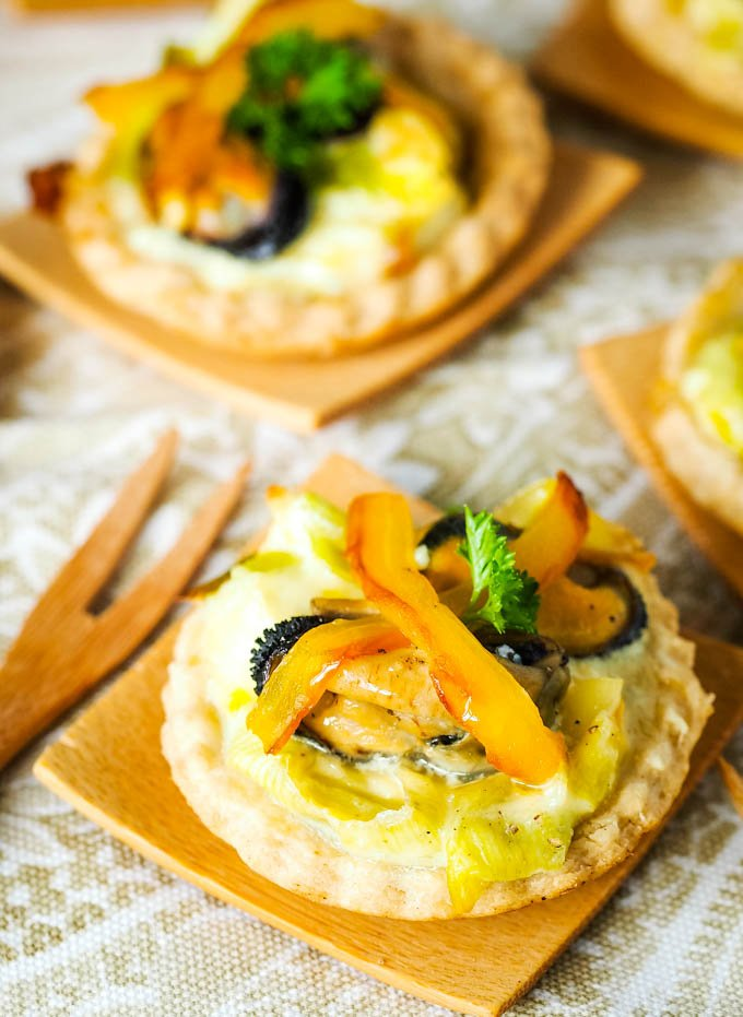 two savoury tarts with small fork