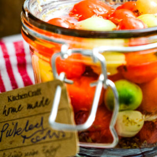 pickled baby tomatoes in jar