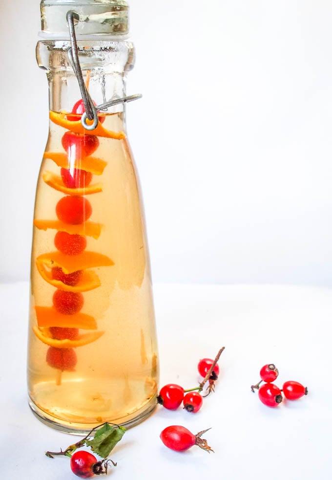 rosehip vinegar in tall bottle