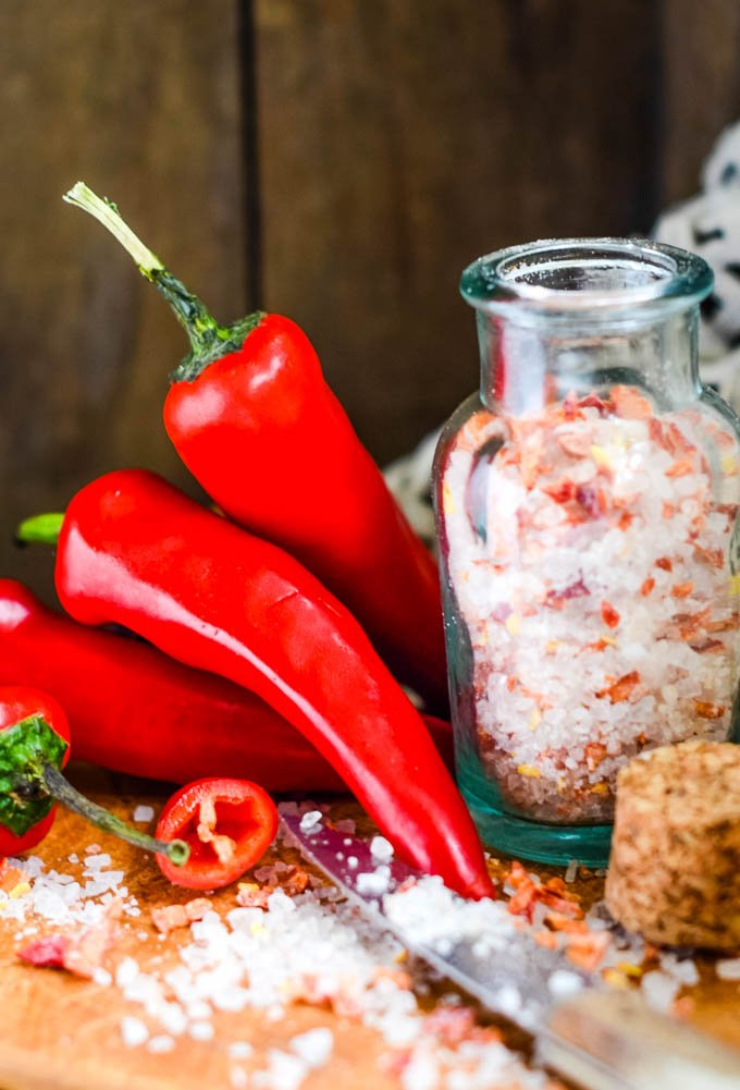 hot and spicy chilli salt in small jars with chilli in front