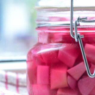 pink pickled turnips in jar