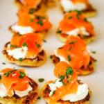 smoked salmon on potato scones on platter