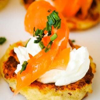close up of single potato scone with smoked salmon