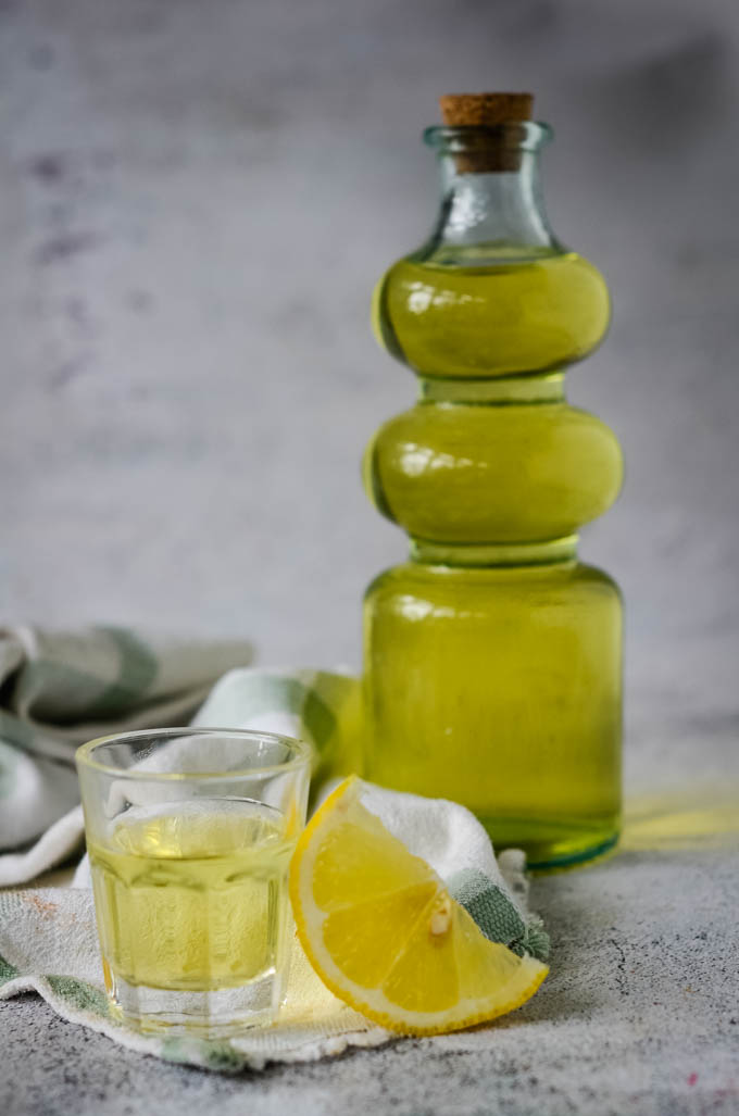 bottle of limoncello and glasses
