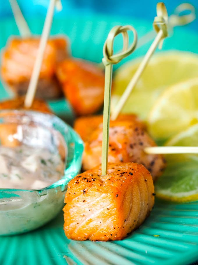salmon cubes on cocktail sticks with dip at side