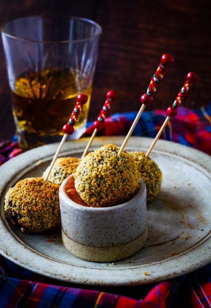 row of haggis truffles with dip
