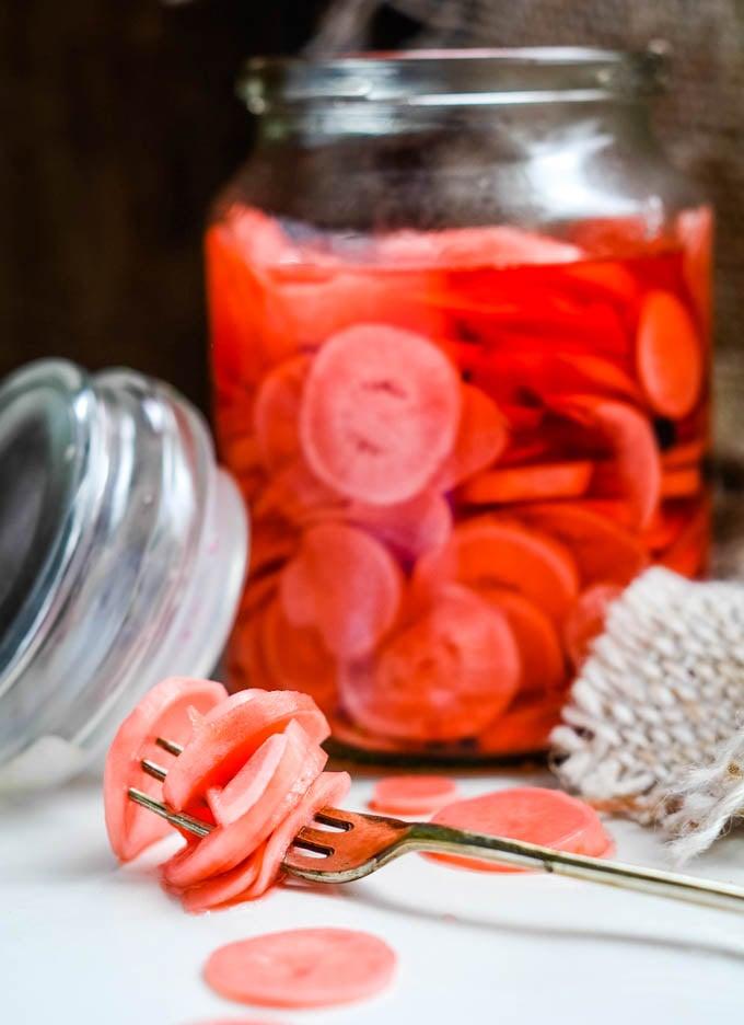 pickled radishes on fork