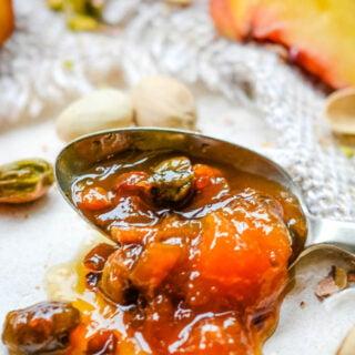 peach and pistachio jam on spoon
