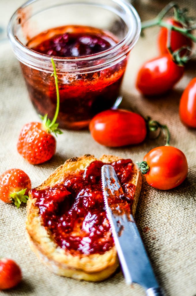 strawberry and tomato jam on toast with fruits scattered around