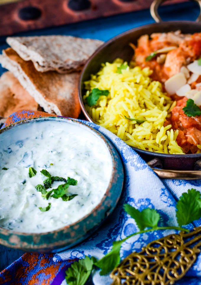 raita dip with curry and rice
