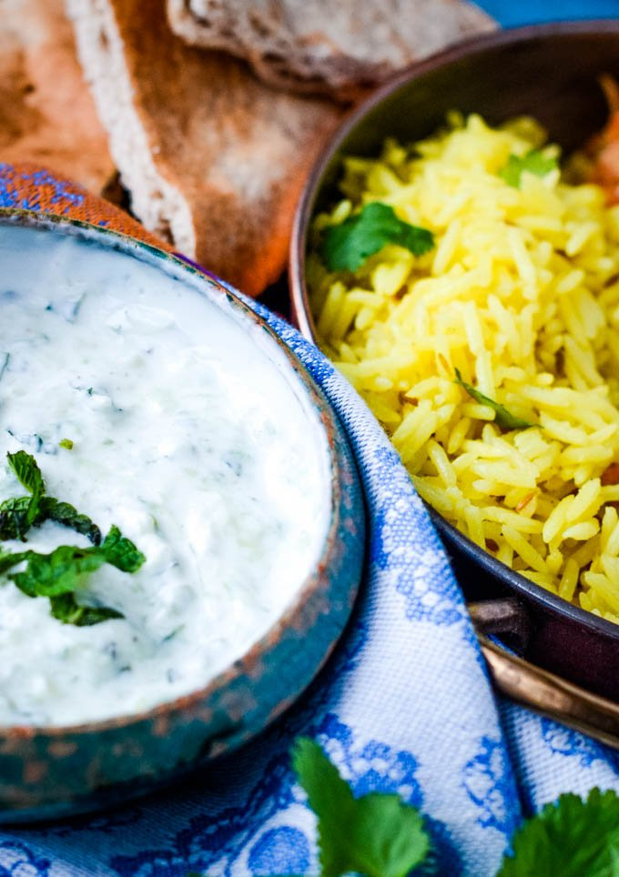 raita in bowl with rice beside