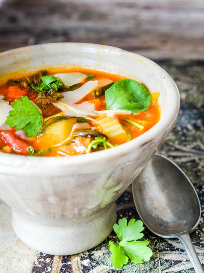 side view of bowl of vegetable soup