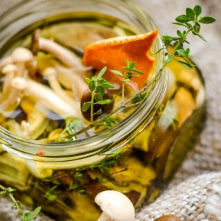 close up of mushrooms in open jar