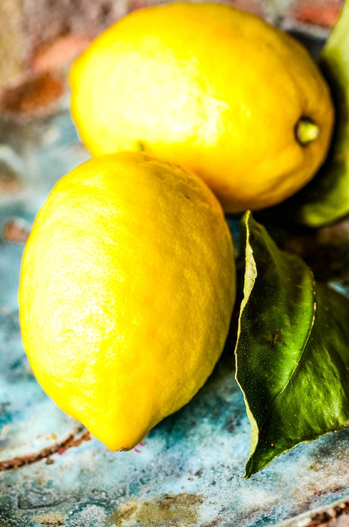 two lemons in blue bowl
