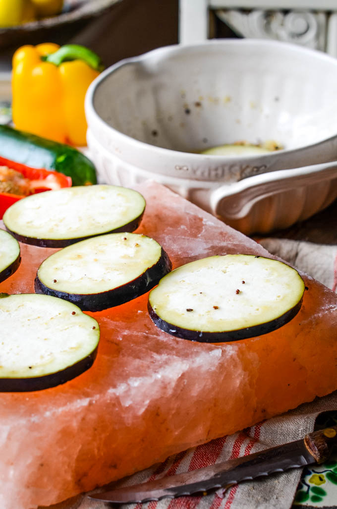 courgettes on salt block with bowl behind
