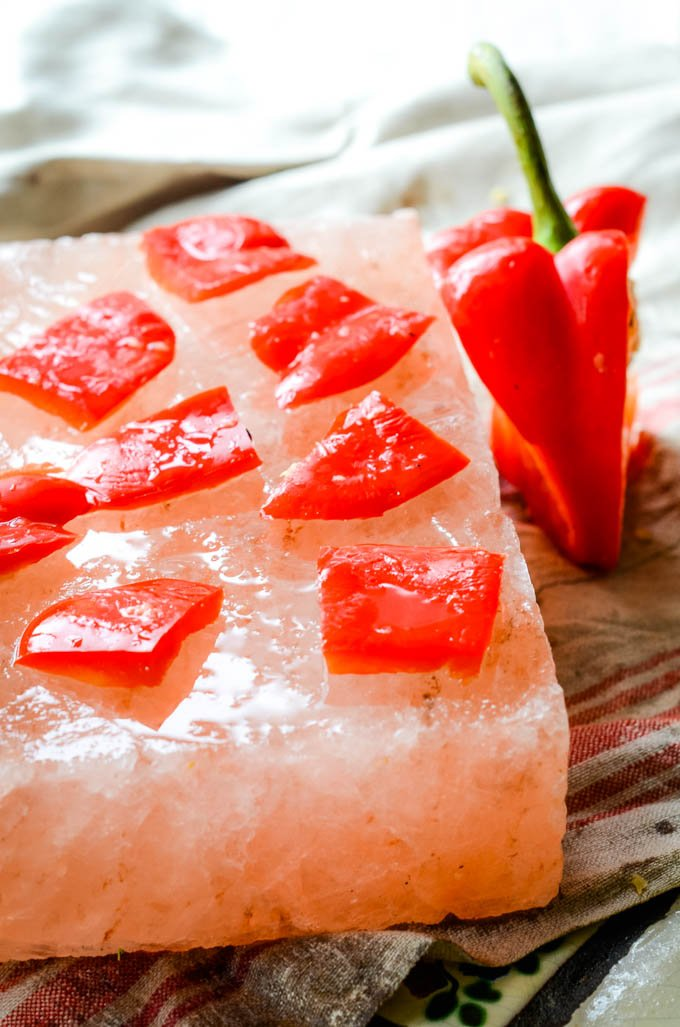 red peppers on salt block