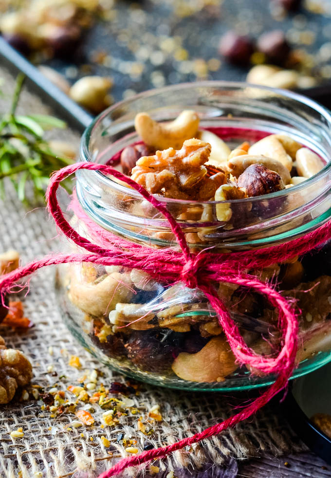 jar of spiced nuts with oven tray behind