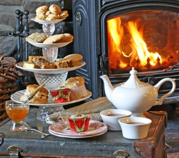 tea table set with marmalade, scones and cakes