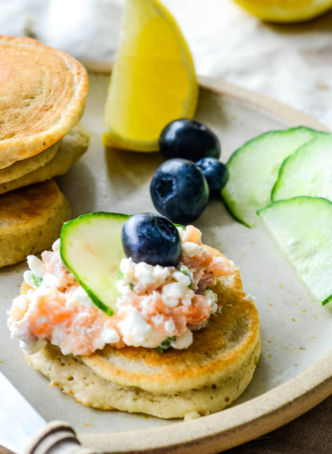 buckwheat pancakes with cottage cheese and smoked salmon close up