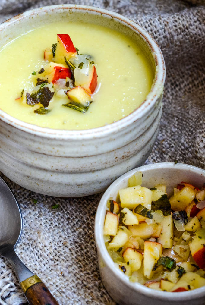 bowl of parsnip soup with small bowl of apple salsa in front