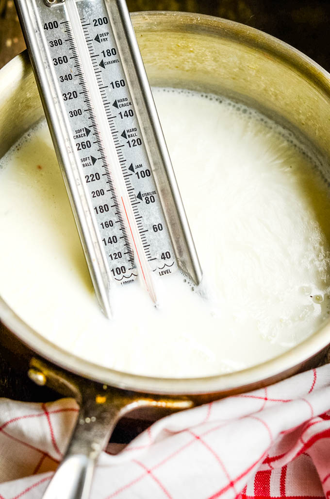 heating milk in pan sghowing thermometer