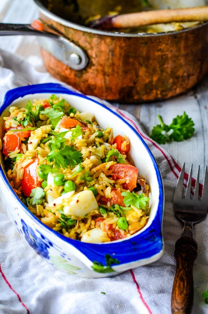 quick and easy kedgeree in bowl with pot behind