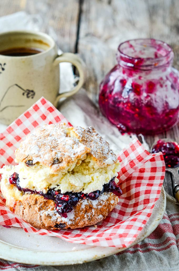 raspberry and blueberry jam with scotch whisky on a scone with cream