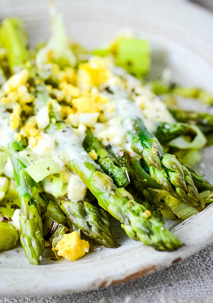 asparagus mimosa on white dish ready to serve