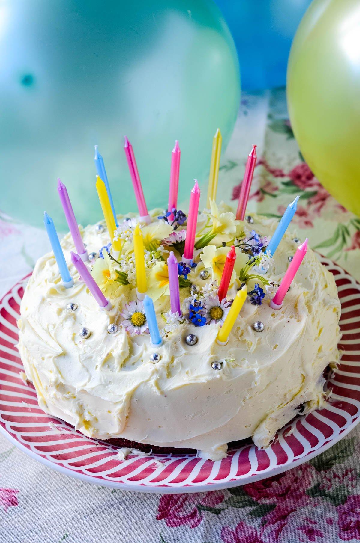 red velvet birthday cake with candles