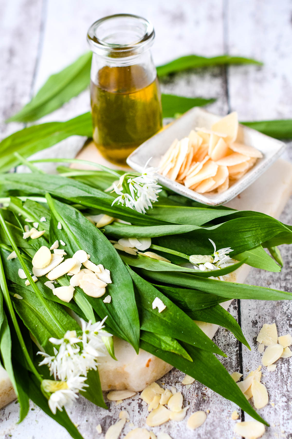 ingredients; wild garlic, parmesan, olive oil and almonds