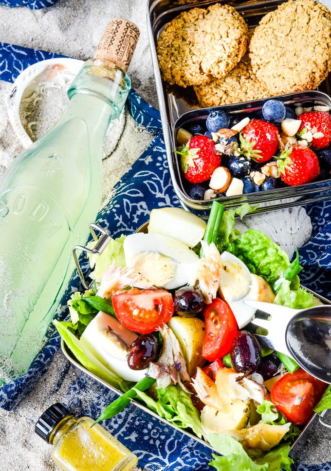 salad nicoise with homemade lemonade and berries all in picnic boxes