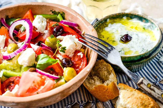 salad and tzatziki on table with bread