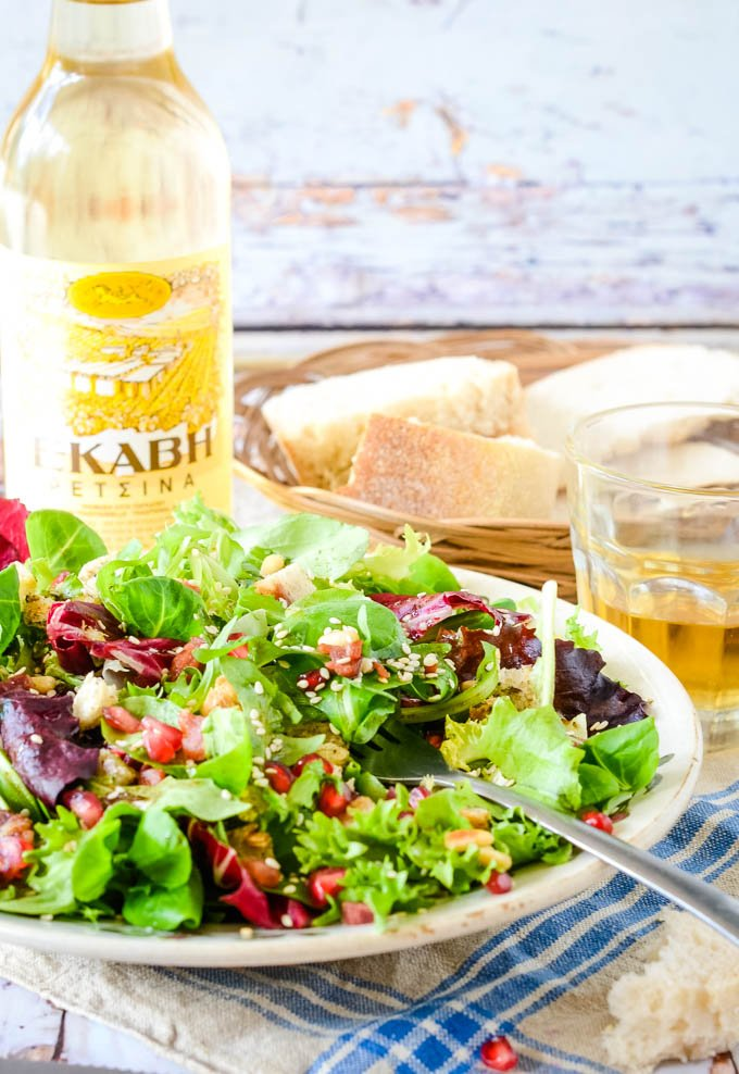 Greek green salad with smoked pork and retsina behind