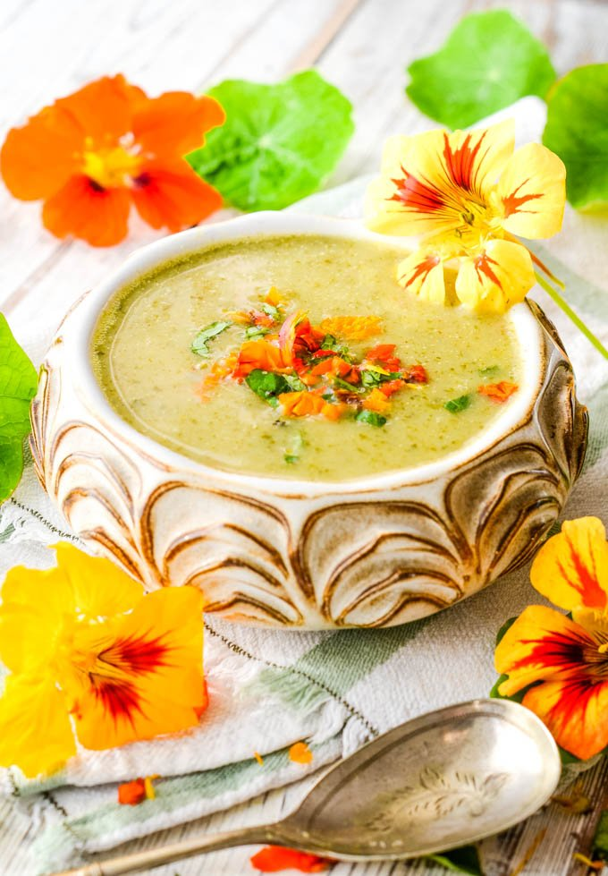 bowl of soup surrounded by flowers