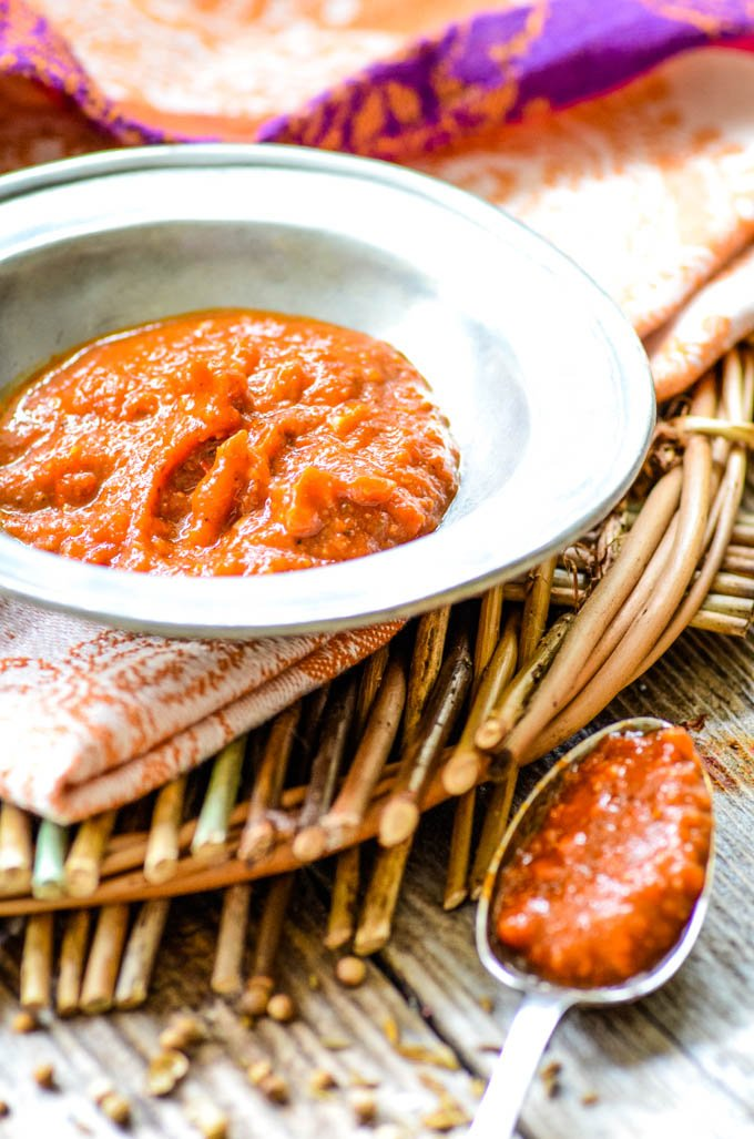 bowl of harissa with spoon at side