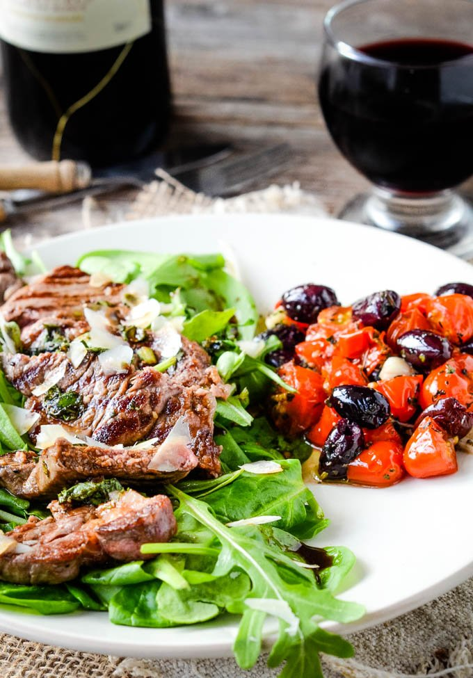 beef tagliata with tomatoes and olives