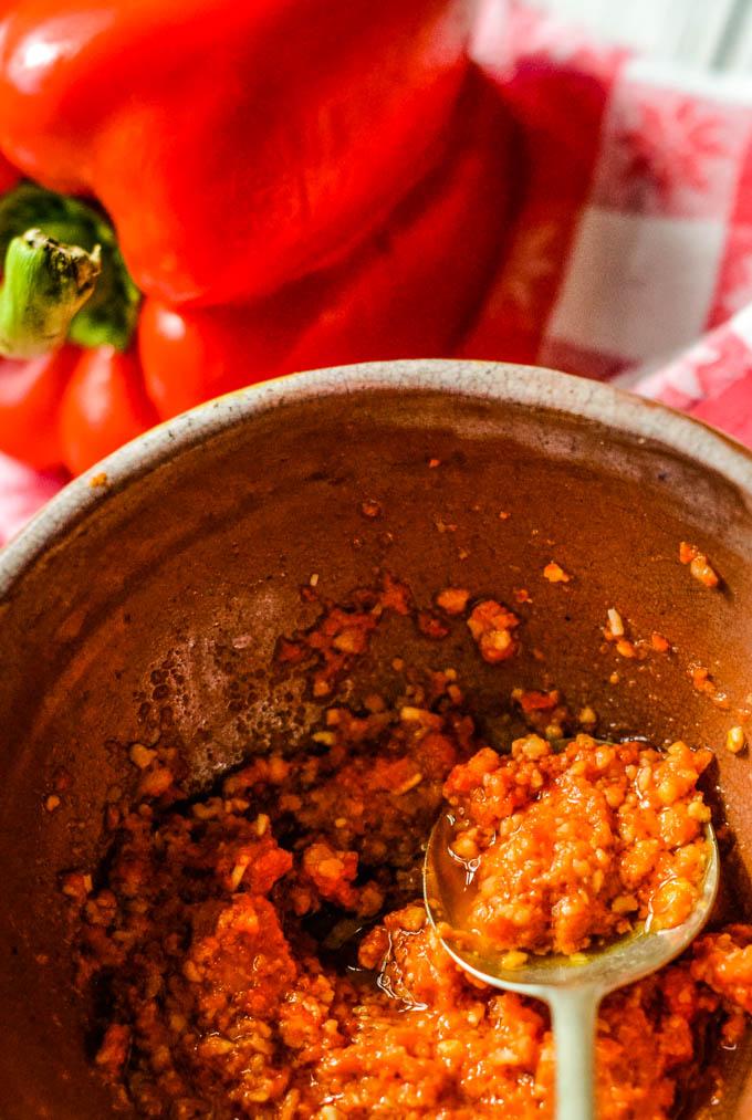 making pesto in bowl