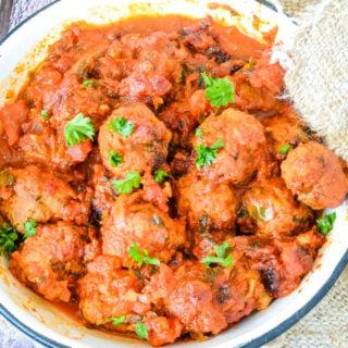 Greek soutzoukakia baked meatballs in tomato sauce